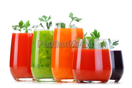 glasses with fresh vegetable juices isolated
