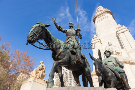 don quixote statue on square of