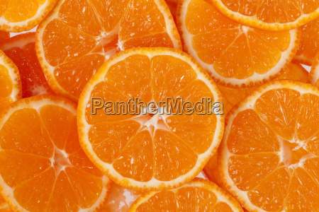 hintergrund der scheiben von clementine fruechte