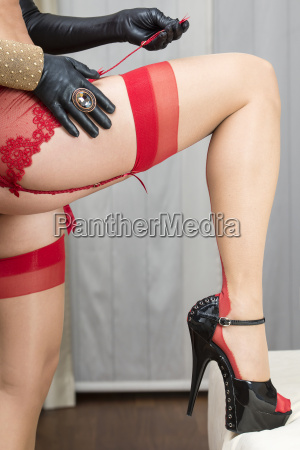 woman attaching stockings to the garter