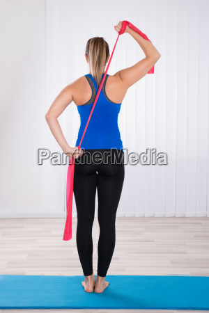 woman doing workout by standing on