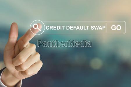 business hand klicken credit default swap