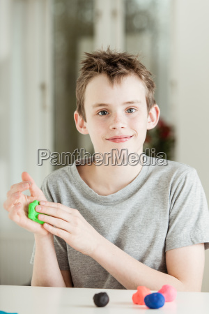 happy male child working with green