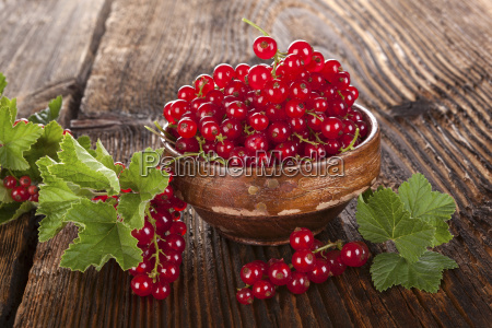 red currant on wooden background