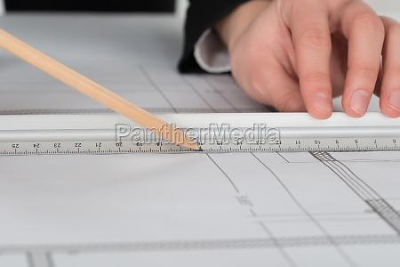 businesswoman hand drawing blueprint