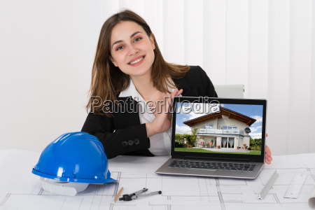 female architect showing picture of house