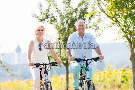senior woman and man on bike