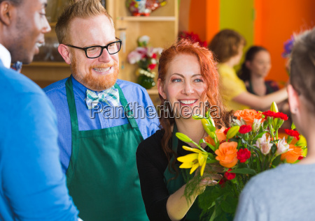 bearded man with woman in flower