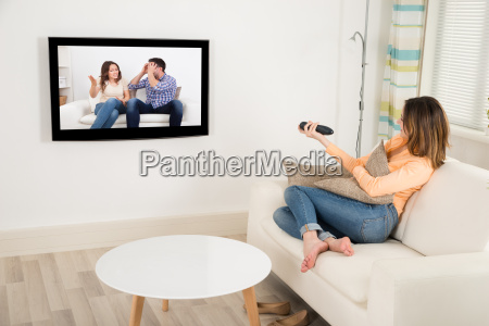 woman watching television in her room