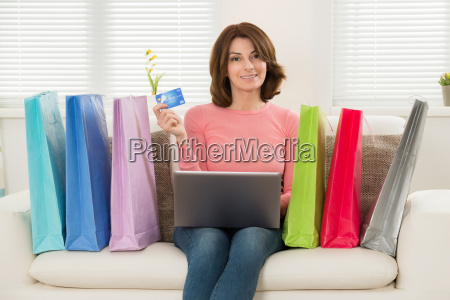 woman using card while shopping on