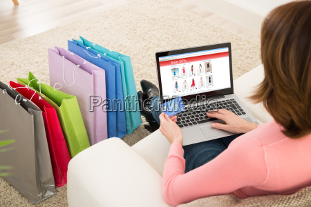 woman with debit card shopping online