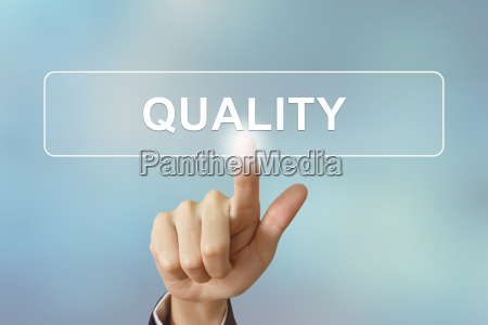 business hand clicking quality button on