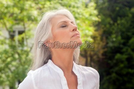 portrait of mature woman enjoying fresh