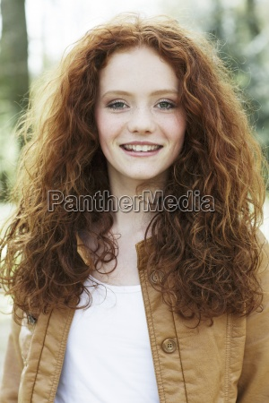portrait of smiling girl with curly