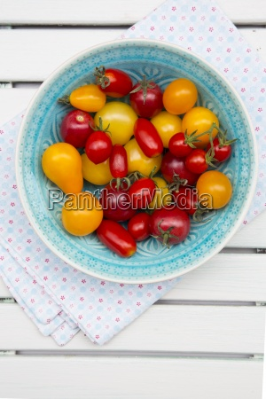 bowl of different heirloom tomatoes