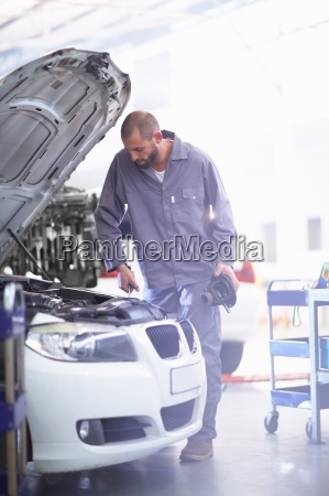 car mechanic at work in repair