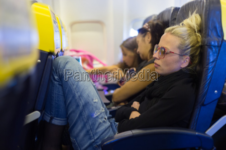 tired lady napping on airplane