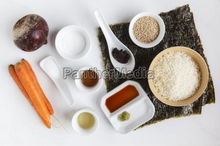 ingredients of maki sushi on white