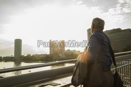 germany frankfurt businessman on bridge over