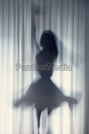 silhouette of a young woman dancing