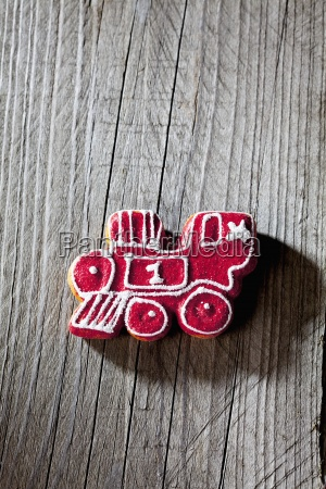 red white gingerbread locomotive on grey