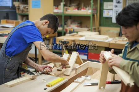 vocational school students working in a