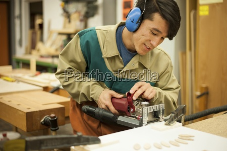 vocational school student working in a
