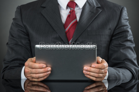 close up of businessman using digital