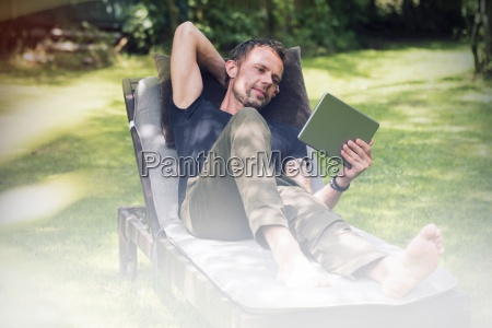 relaxed man lying in sun lounger