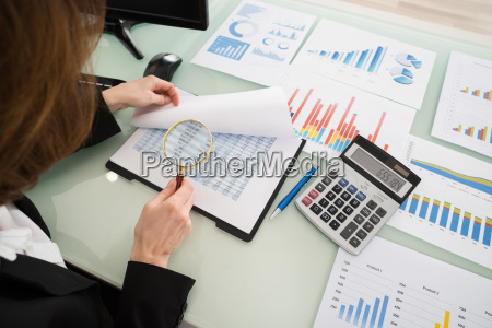 businesswoman looking at financial report