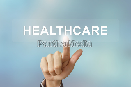 business hand clicking healthcare button on