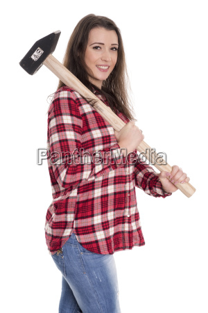 young woman carrying a sledgehammer over