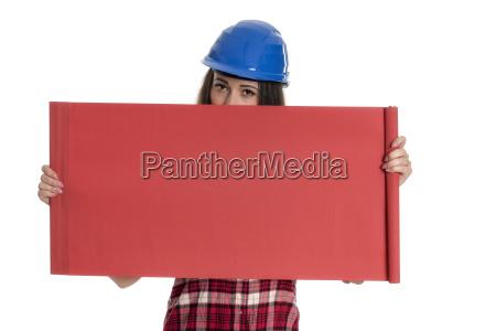craftsman holding an advertising sign