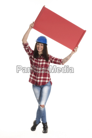 woman with construction helmet holds up
