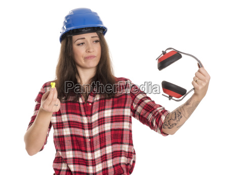 woman with construction helmet holding ear
