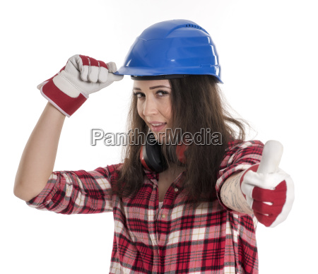 female artisan with helmet showing thumbs