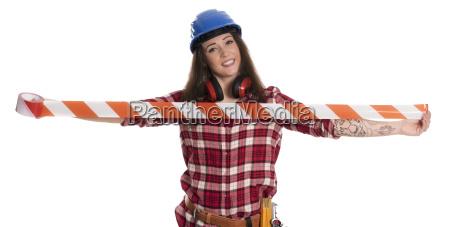 female artisan holding red barrier tape