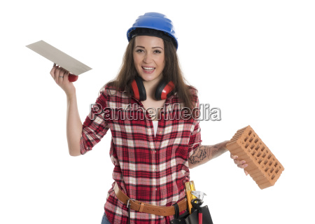 female artisan with trowel and brick