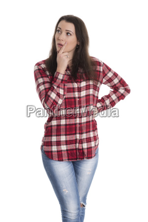 woman in plaid shirt looks contemplative