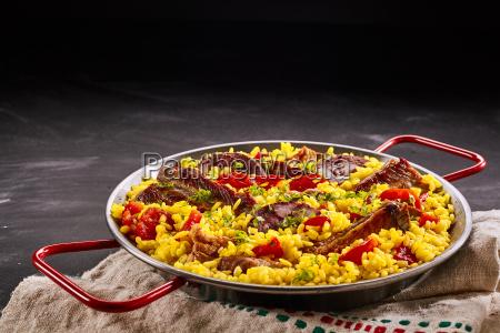 rustic metal dish of paella al