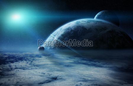 sonnenaufgang ueber planeten im all