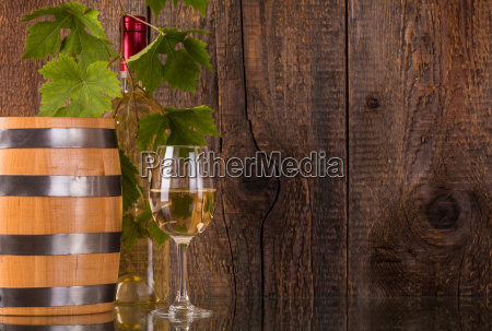 glass of wine with barrel white