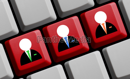 three business icons on computer keyboard