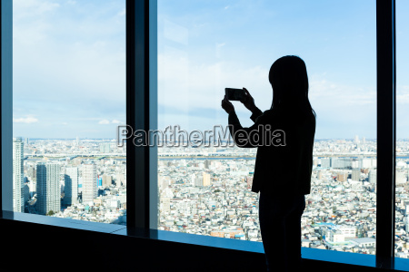 silhouette of woman take photo on