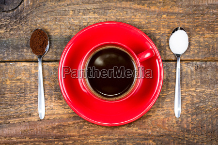coffee cup with coffee and sugar