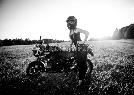 beautiful woman on the motorcycle black