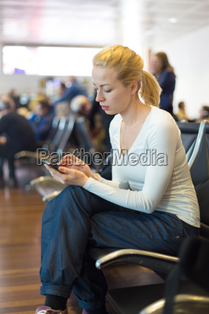 female traveler using cell phone while
