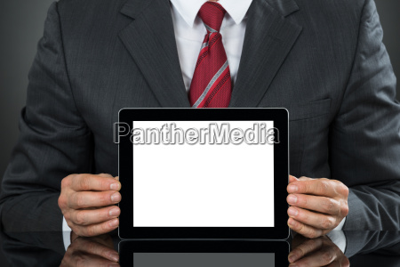 businessman showing tablet with blank screen