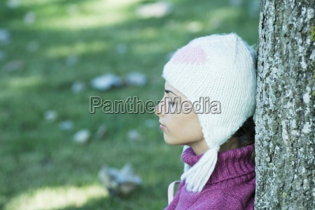 young woman wearing knit hat leaning