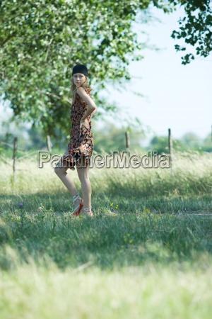 young woman walking along rural path